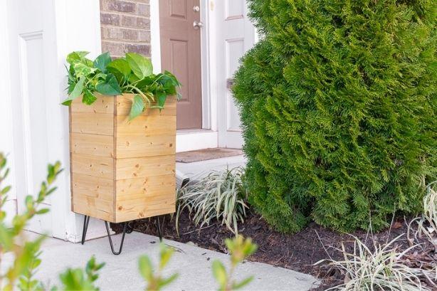 Porch Planter with Hose Storage